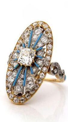 Ring… An Antique Diamond Ring, by Tiffany & Co., circa 1900. Set with a cushion-cut diamond at center within radiating lines of blue enamel and diamonds.