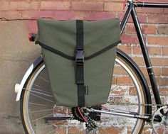 """Unlike any other pannier out there--classically styled, water-resistant panniers. """"Elinor,"""" the wedge shaped pannier, is designed to minimize heel strike..."""