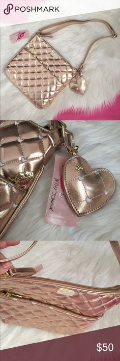 """Betsey Johnson Rose Gold Crossbody Brand new, measures 10"""" x 12"""", adjustable strap, rose gold, gold hardware, kissy lip zipper, heart charm. Quilt pattern on the front. 1 outside pocket on the front and inside has 1 zipper pocket and 1 open pocket in addition to the main compartment. Rose Gold LBZIPPY Betsey Johnson Bags Crossbody Bags"""