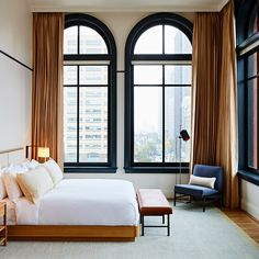Gachot Studios designs boutique hotel in Detroit for watchmaker Shinola: Gachot Studios custom made the mohair sofas, blue paint and fire grate that feature in this hotel in Detroit, designed for American watch brand Shinola. Decoration Inspiration, Interior Design Inspiration, Interior Ideas, Home Bedroom, Bedroom Decor, Casa Hotel, Hotel Bed, Hotel Lobby, Hotel Room Design