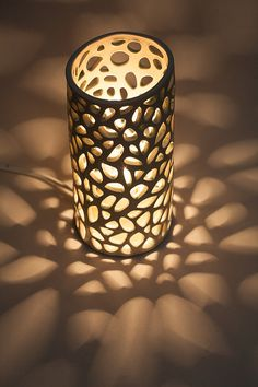 This mood ceramic lamp is inspired by the shapes of the corals in the diverse and amazing reefs they build. It is artistic interpretation of the