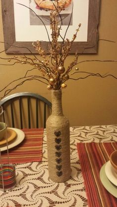 Twine wrapped wine bottle with acrylic stenciling. By Amanda Smolarek.