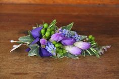 A beautifully light and elegant corsage of lilac Freesia and Muscari with Rosemary and Green Hypericum