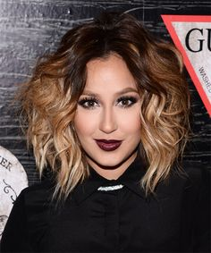 Adrienne Bailon Hairstyle - Medium Wavy Casual - Dark Brunette. Click on the image to try on this hairstyle and view styling steps!