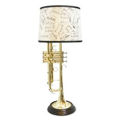Jamie Cornett breathes new life into well-used instruments by turning them into bright & brassy lamps. After this horn played its last notes, the artist fixed each piece in its own base & a shade featuring sheet music.