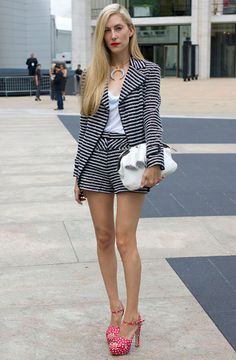Joanna Hillman- striped suit and candy colored platforms