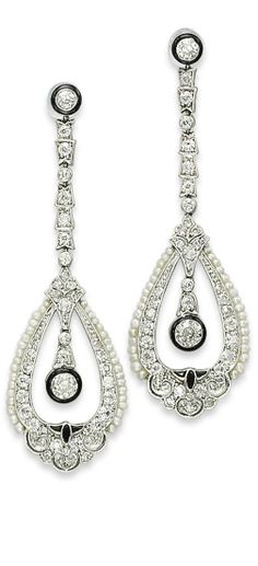 A PAIR OF ART DECO DIAMOND, ONYX, ENAMEL AND PEARL EAR PENDANTS Each top designed as a circular-cut diamond in a black enamel collet, to the diamond-set link chain and pear-shaped stylized openwork pendant, with pearl frame, onyx detail, and circular-cut diamond in a black enamel collet, circa 1920,