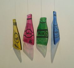 Glass bottles designed and hand-painted by TuulaGiraldoArtGlass