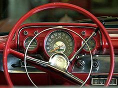 "Look at the size of that steering wheel. The metal ring in the center was the horn. Note how huge the ""blink"" turn signal shift is."
