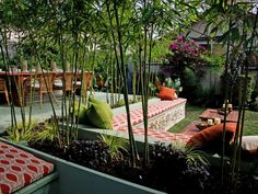 Distinct living and dining spaces and lots of outdoor seating make this sleek Asian-inspired space perfect for outdoor soirees. Bamboo serves as a living divider to separate the two spaces. Design by Jamie Durie