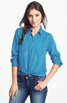A pop of bright blue on a classic button-front shirt.