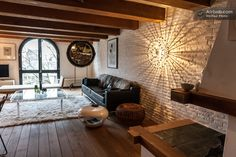 Amsterdam canal apartment with exposed beams, curved window and brick wall. Love.