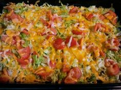 Taco Casserole 1 7oz. bag Nacho Cheese Doritos, crushed; 1 lb. hamburger, browned; 1 pkg. taco seasoning, mixed according to direction;s 1 (8 oz.) pkg. shredded Cheddar cheese; 1 (8 oz.) pkg. shredded Mozzarella cheese; Shredded Lettuce' Sliced tomato. Layer ingredients in 9 x 13 pan as listed - crushed chips, meat and seasonings, 2/3 of cheese, lettuce, tomato, and remaining cheese. Bake at 350 degrees for 15 minutes.