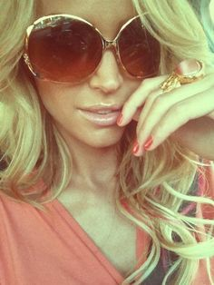 Loooove the whole 70s glam look!!!! Great sunnies, amazing hair and love the YSL ring!