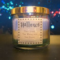 Deathly Hallows Scented 4 oz Candle:  Cloak, Wand, and Stone with Suprise INSIDE!