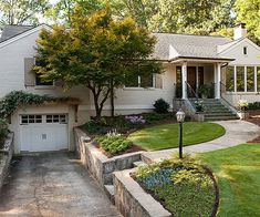 After: Warmer Welcome .... this is sort of the same layout of my house/yard, I love the stone retaining wall and the arbor over the garage and the walk is further away from the side of the house, which makes it easy to see and approachable....