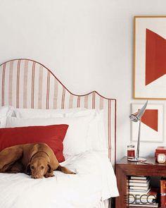 Buda, a Hungarian vizsla, is a beautiful contrast to the bright color palette designer Nicholas Haslam utilized in artist Hugh Bush's bedroom.