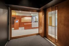 Doors of TGAS - This Entrance Door for Johnson-Kulukundis Family Gallery is made of copper over wood frame, it has solid copper handles and glass viewing ports.  Photographer: James Leynse Photography #DoorsOfTGAS #door #TGAS #architecture #copper