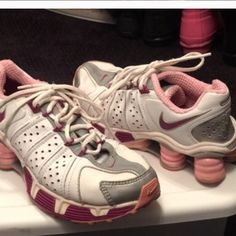 Nike shox gym shoes White, maroon and pink Nike Shox gym shoes.  These have been worn but still look awesome.   The size is a 5 youth.   Additional pictures of them on in another listing in my closet. Nike Shoes Athletic Shoes