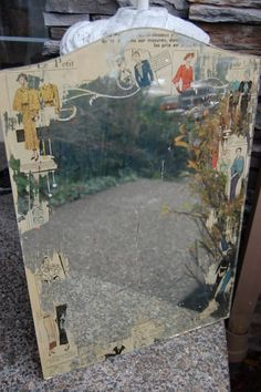 "get an old mirror, spray Easy Off oven cleaner in a random fashion (I chose to do it around the edges) on the side that has the mirror finish, wait about 15 to 20 minutes and wipe off the parts that have been ""eaten"" by the powerful spray. Then you can have fun decoupaging the back with paper or fabric, so random parts of the mirror will reveal your surprises"