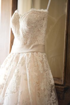 Cute lace wedding dress. View the full wedding here: http://thedailywedding.com/2016/07/15/winery-bike-wedding-teresa-aaron/