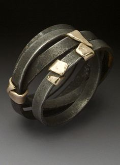 """Ring   Peg Fetter.  """"Street Cleaner"""".  14k yellow gold and oxidized steel"""