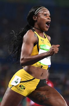 Jamaica's Elaine Thompson celebrates after she won the Women's 100m Final during…
