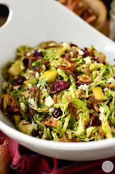 Fall Shredded Brussels Sprouts Salad by iowagirleats: Crispy and crunchy, and full of fresh and savory flavors. #Salad #Brussel_Sprouts #Cranberries #Pecans #Gorgonzola #Healthy