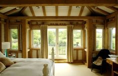 A very cosy bedroom in oak frame tower bedroom with corner windows