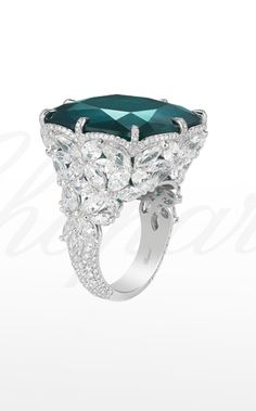 Chopard ~ Ring from the Red Carpet Collection with a cushion-shaped emerald set within a meadow of diamond flowers