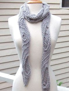 A great skill-building design!   The lace pattern consists of 3 simple stitches, which are repeated on every row. The quirky construction makes the fabric reversible, so the fabric peeking through the keyhole openings on both sides of the scarf never show a wrong side. Whether chunky and casual, silky and elegant or romantically light as a feather, this scarf can complement any outfit. Knit it short, knit it long, knit it fine, knit it thick -- the design is very adjustable. Make medium, ...