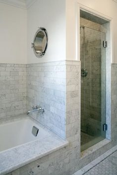The bathroom was reworked to include a separate walk-in shower and tub. A porthole window was installed in the shower for natural light.