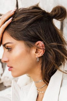 This new earring trend won't weigh you down. It's an elevated take on the ear cuff called the orbital cuff, giving the illusion it's pierced through the conch. No extra needles required.