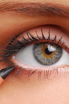"A thick liner can leave the upper lids looking heavier than they are."" The best technique: Trace a brown pencil liner along the upper lash line (into the roots of the lashes), focusing on the outer corners; smudge it with a Q-tip."