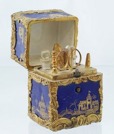 lovely when open & even more beautiful when closed...; 18th/early19th c. Blue and gilt enameled ladies necessaire with hinged top, fitted interior with 2 scent bottles, applicator, scissors, buttonhook, needle, cuticle tool...