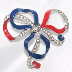 Here for your consideration is this patriotic ribbon shaped into a bow knot pin made by the Trifari Company in 1940. This collectible brooch was