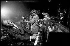 "Dennis Stock View profile USA. San Francisco, California. 1958. Earl HINES, American piano player and band leader. Jimmy ARCHEY, American trombone player. Francis Joseph ""Muggsy"" SPANIER, American cornet player and band leader. Earl WATKINS, American drummer. Magnum Photos -"