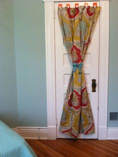 Room decorating ideas: fabric panels on your closet doors in the house. Easy way to coordinate with your bedding, and really livens up the rooms!