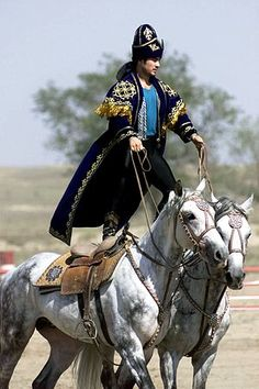A Kazakhstan performer demonstrate the long equestrian heritage as part of the gala concert during the opening ceremonies of Central Asian Pescekeeping Battalion.