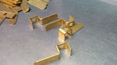Sheet metal brass electrical brackets manufactured by V and F Sheet Metal in Fareham, Hampshire, UK http://www.vandf.co.uk/blog/brass-sheet-metal-used-to-produce-electrical-contactor-brackets/