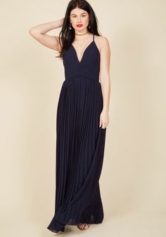 <p>To support your best pal on their special day is an incredible honor, and calls for a classic gown like no other. This grey maxi dress - crisscrossed at the back, overlapped with waistline pintucks, and finished with an accordion-pleated skirt - celebrates the occasion in style that honors the incredible bond you share!</p>
