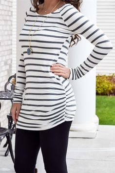 "All orders placed by Dec. 18th will ship in time for ChristmasThis long tunic with side ruching on the sleeves and bottom of the shirt will be your new favorite top! It is high quality, so soft and SO VERY comfy (not to mention it looks great for fall!) It is long enough to wear with leggings so you'll be ultra comfortable and looking chic at the same time! 95% Rayon 5% Spandex  Sizing: Small 0-4Medium 6-8Large 10-14Model is 5'7"" and wearing a small."