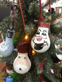 Hand painted light bulb ornaments. Snowman and Santa.