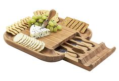 One of my most popular items: the Picnic at Ascot Malvern Cheese Board Set, Bamboo. The cracker rim on this bamboo cheese board is genius. A hidden drawer stores the stainless steel tools. Cheese Board Set, Picnic At Ascot, Bamboo Board, Charcuterie Board, Diy Wood Projects, Cookies Et Biscuits, Kitsch, Kitchen Dining, Kitchen Wood