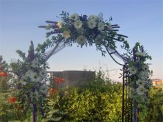 Decorated Arch  : Decorated with fresh flowers for your beautiful garden wedding.