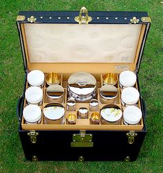 Louis Vuitton vintage picnic basket. Has china and silver sandwich boxes. Now that's fancy shmansy!