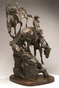 """""""Out of the Clouds"""" - this limited edition 35"""" H x 18"""" L x 11"""" D bronze sculpture depicts a cowboy on a pack trip with two horses navigating a steep rocky descent. Jackson Hole art gallery. #cowboy"""