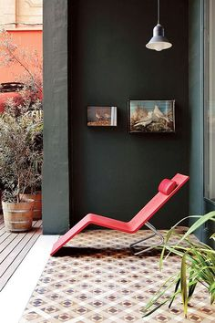 dreaming of summer days | modern red chaise lounge on tiled patio via sfgirlbybay | urban oasis | indoor outdoor space | dark green wallpaint |