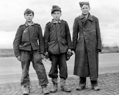 """Three Hitlerjugen (Hitler Youth) """"soldiers"""" captured by American forces in Germany, April 1945. [1700x1360]"""