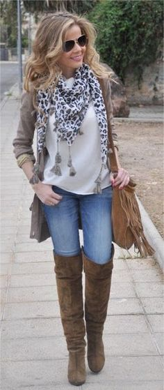 Blue jeans, chocolate high boots and bag, white tee shirt, black and white sweater and grey jacket